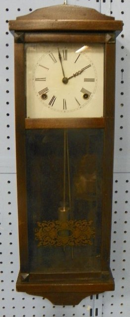 28: Wall clock with gold design on glass