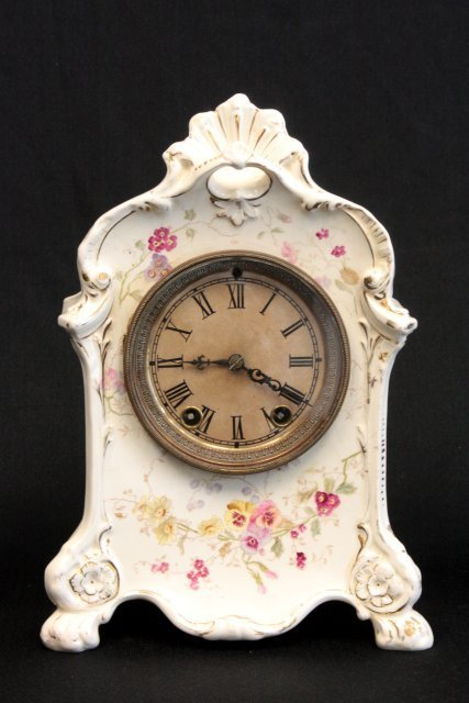 31: White porcelain clock with flowers