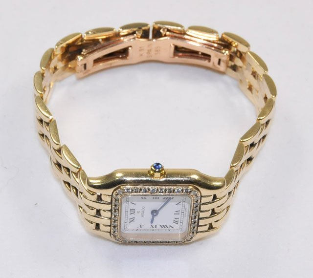 1001: Ladies 14kt Movado watch with diamonds