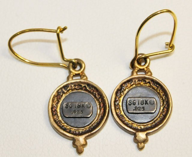 1014: Pair 18kt gold earrings - 2