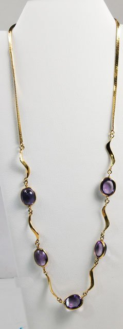 1015: 14kt yellow gold & amethyst necklace