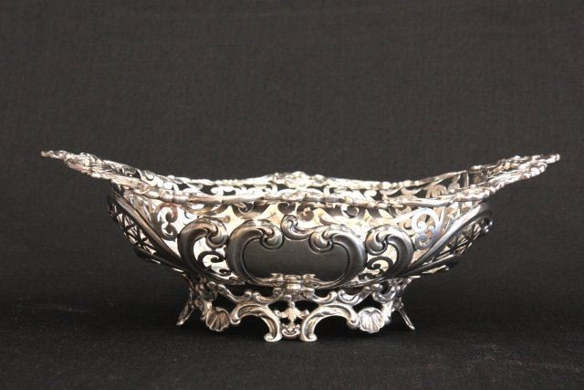 247: Sterling silver Repousse bowl on scroll legs