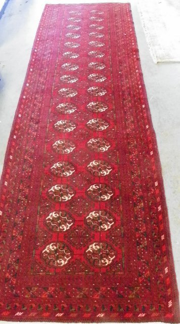 7: Long Bokhara runner with red ground