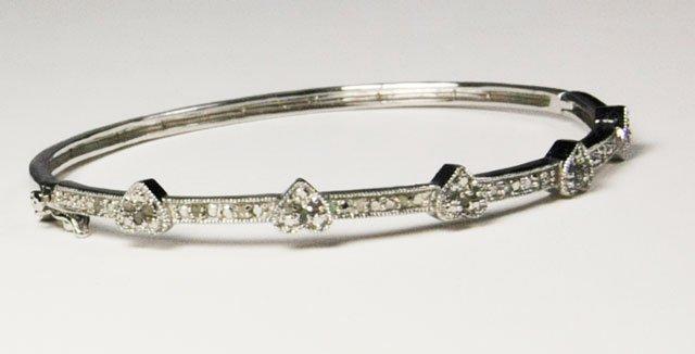 1009A: 14kt white gold & diamond bangle bracelet
