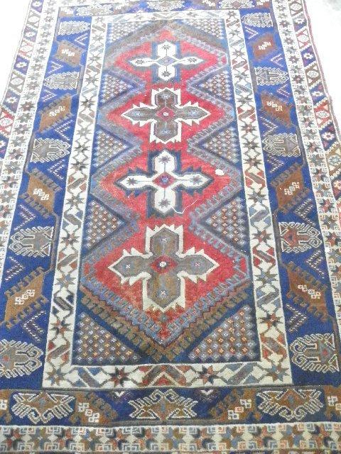 5: Kazak rug