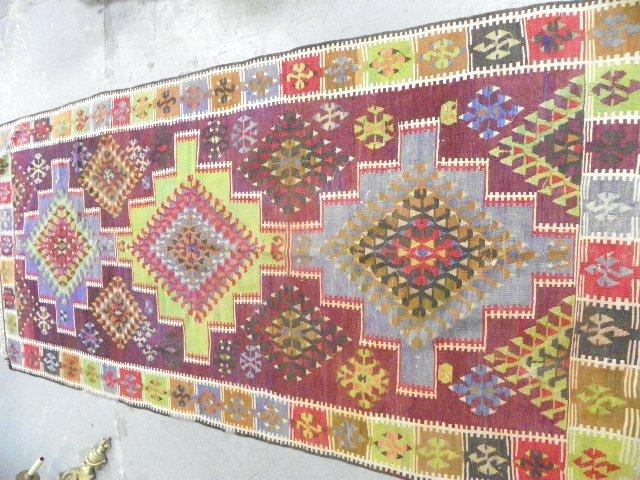 12: Colorful Turkish Kilim rug