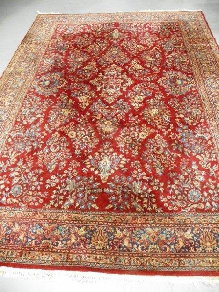 17: Red field Karastan rug