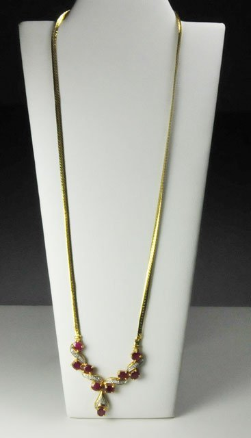 1003: 14kt yellow gold ruby & diamond necklace