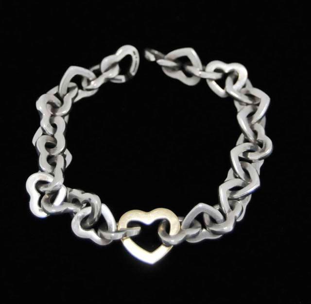 1017: Tiffany & Co. sterling silver & 18kt gold bracele