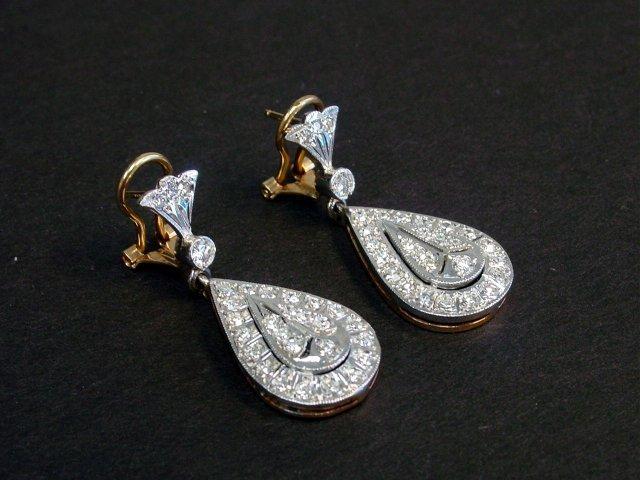 1002A: Pair 14kt white gold &diamond earrings