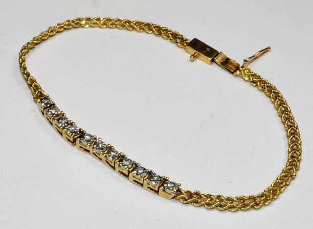 1010: 14kt gold & 11 diamond bracelet