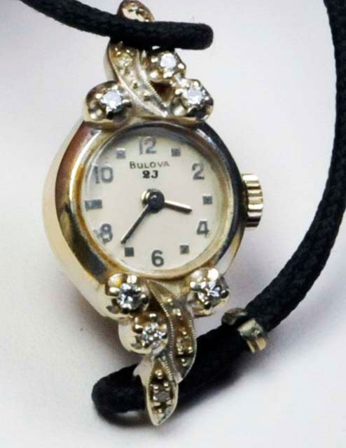 1011: 14kt ladies diamond Bulova watch