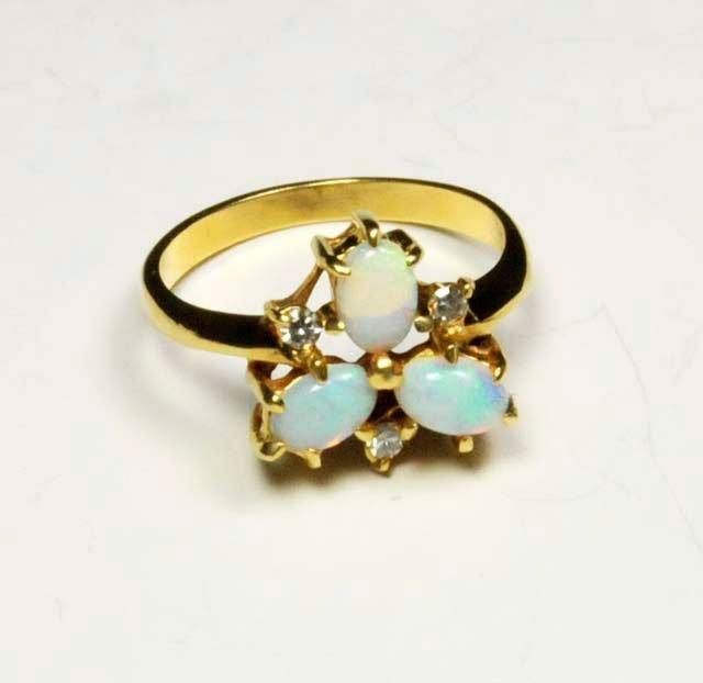 1019: 14kt gold opal & diamond ring