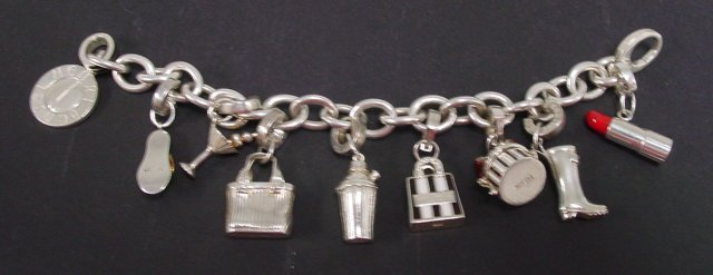 1038: Sterling charm bracelet made for Henri Bendel