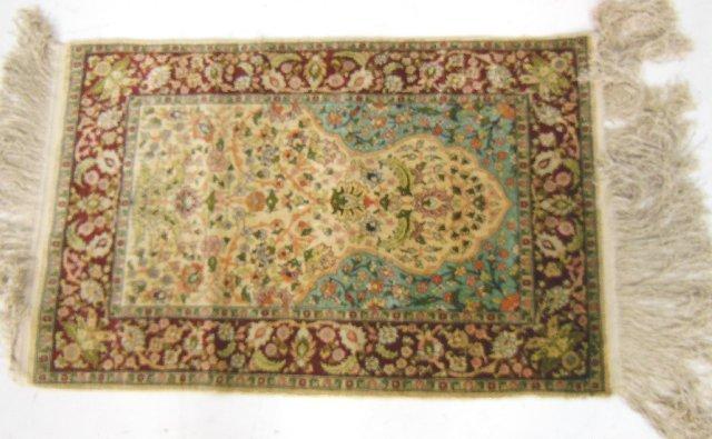 12: Turkish Hariki silk rug with fringe