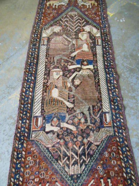 14: Antique Persian rug depicting animal