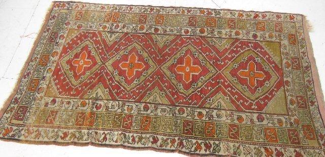 17: Turkish orange rug