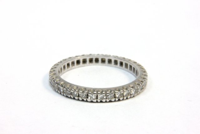 1010: Channel set diamond wedding band