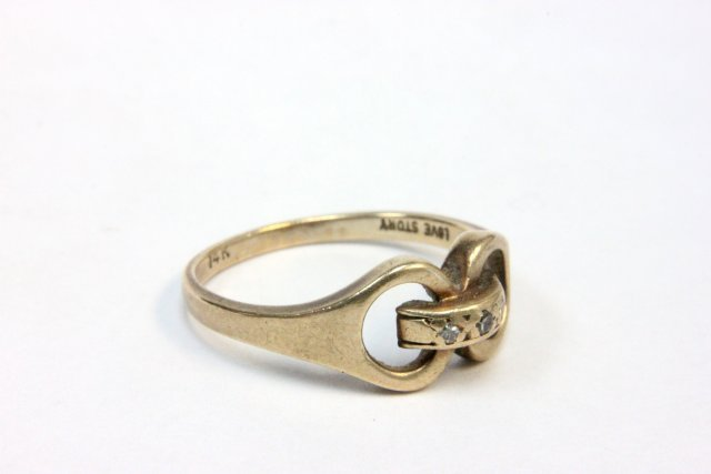 1013: 14kt gold & 2 diamond chip friendship ring