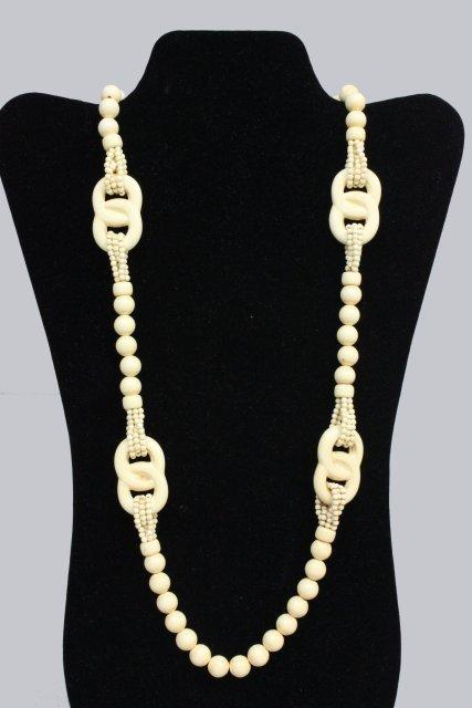1022: Victorian bone beaded & braided necklace