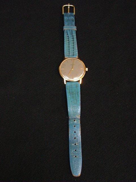"18kt gold ""Marvin"" man's flat wristwatch"