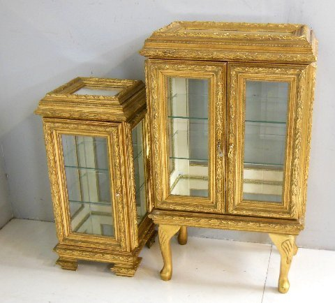 2 gold wood curio cabinets