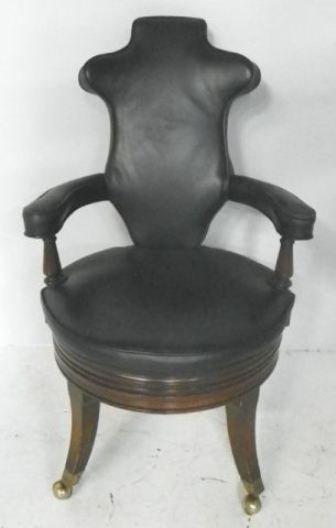 Old mahogany swivel office chair
