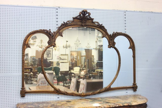 Carved walnut mantle mirror with gilt highlights