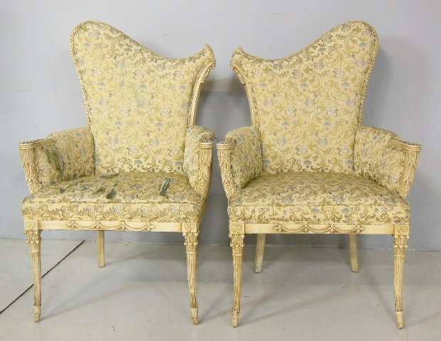 Pair paint decorated carved assymetrical chairs