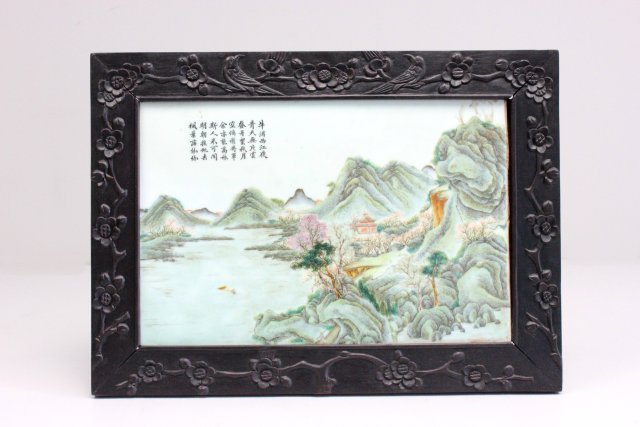 Chinese porcelain plaque in carved wood frame
