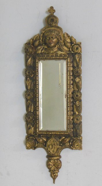 Carved gilt wood figural mirror