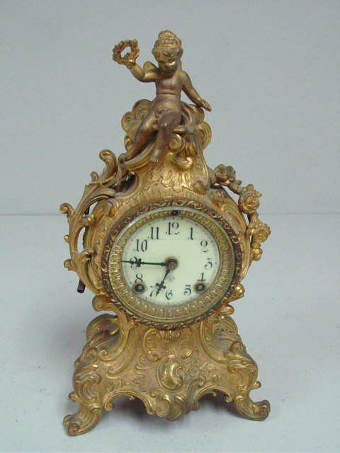 Louis XV gilt metal mantle clock
