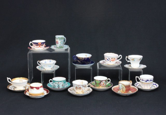 Group of 13 unusual cups & saucers