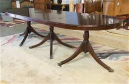 Triple pedestal mahogany dining room table