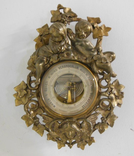 """Cherub"" bronze barometer with ""Foliate"" design"