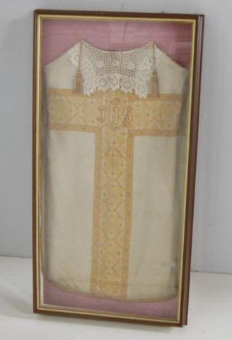 Framed vestment mounted on a pink moire liner
