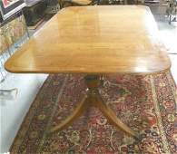 Baker Figured mahogany banded dining room table