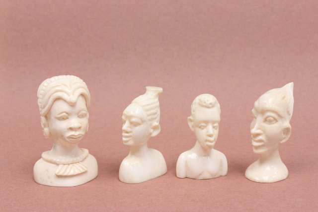 """4 African carved bone bust of """"Tribal Figures"""""""
