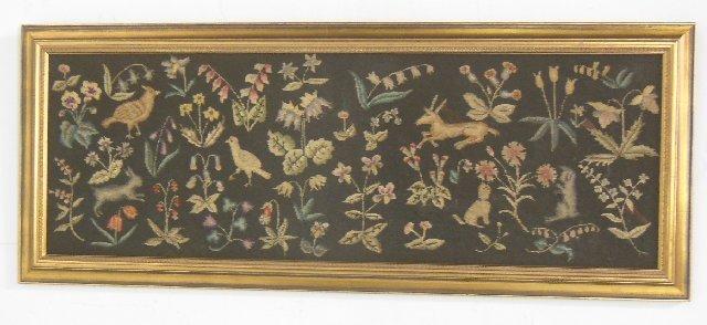 "Framed needlepoint depicting ""Animals & Flowers"""
