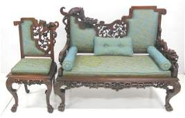 Heavily carved Chinese loveseat  matching chair