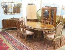 11 piece carved walnut dining room set ca. 1940's