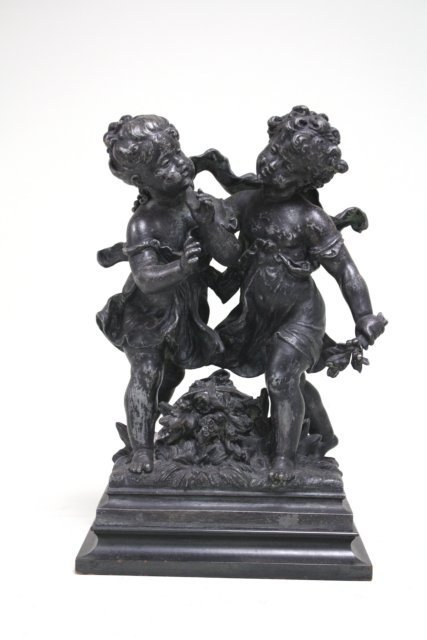 White metal grouping of 2 children signed Moreau