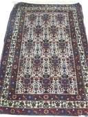 Semiantique Persian scatter carpet ca 1940s