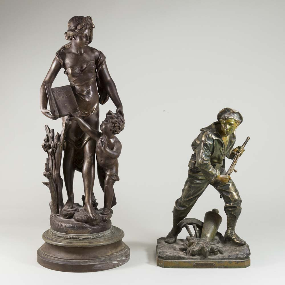 Two White Metal Figures