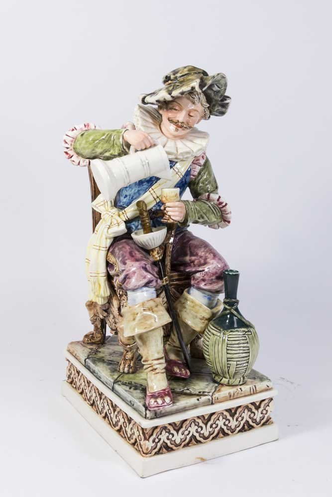Majolica Figure, Seated Man with Cup