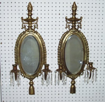 22: PAIR OVAL MIRRORS WITH SCONCES.