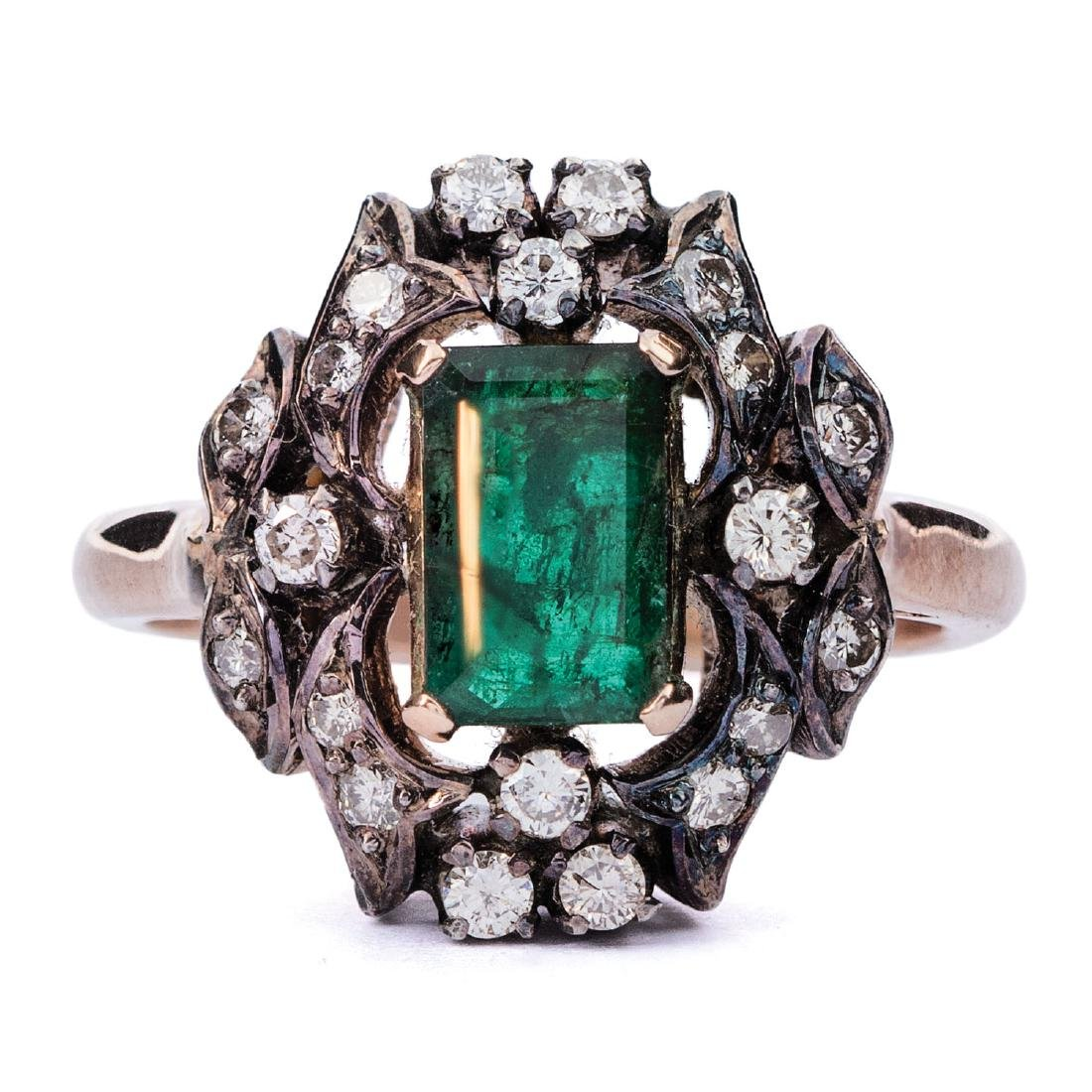A vintage emerald and diamond ring