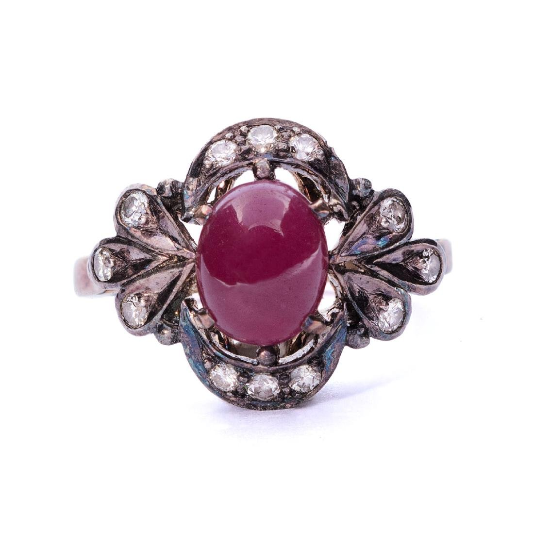 A vintage star ruby and diamond ring