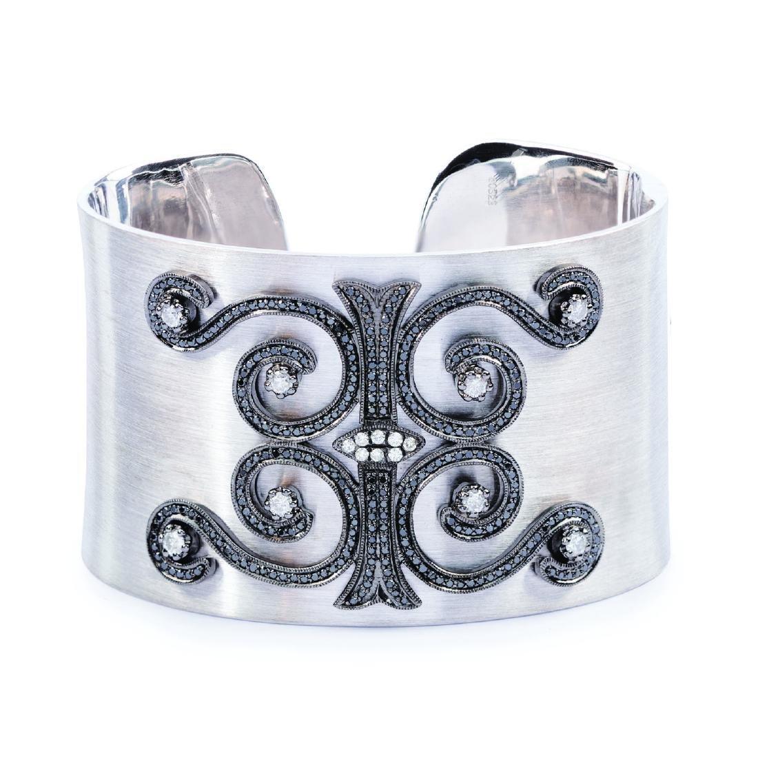 A black and white diamond arabesque cuff