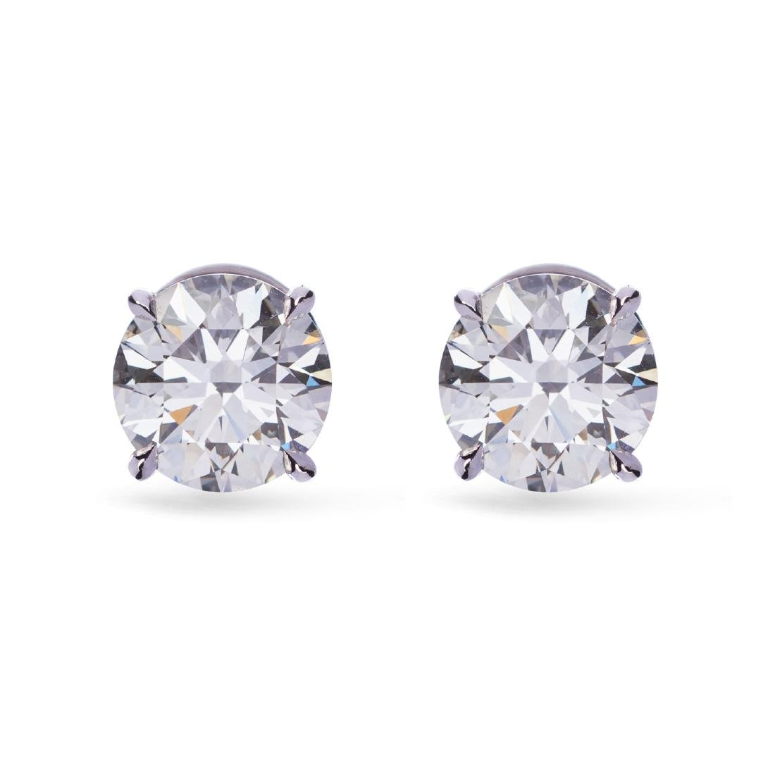 A lively pair of diamond stud earrings